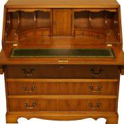 Reproduction_5_Drawer_Bureau_yew_mahogany
